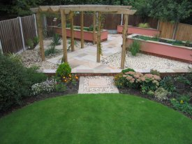 AFTER ADDING A TIMBER STRUCTURE, RAISED BEDS AND A NEW PAVED AREA GIVES A NEW LEASE OF LIFE TO THIS TIRED LAWN AIGBURTH, LIVERPOOL