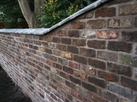 AFTER THIS UNSAFE AND UNSIGHTLY WALL HAS BEEN REBUILT, BY CLEANING THE OLD BRICK AND RELAYING WITH THE BROCKSTONE PRECISION CRESSINGTON PARK