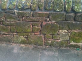 BEFORE SANDSTONE WALL REPOINTING
