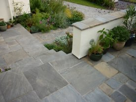 AFTER ALTERATING THE STEPS TO THE PATIO USING GLOBAL STONE OLD RECTORY THE AVAILABLE SPACE HAS BEEN MAXIMISED CRESSINGTON PARK