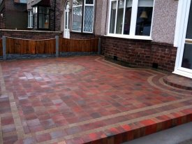 AFTER USING TOBERMORE SHANNON BLOCK PAVING IN HEATHER WITH A PERFECT CIRCULAR FEATURE ENHANCES THE OVERALL LOOK OF THIS  FAMILY HOME  IN GARSTON