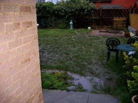 BEFORE INDIAN STONE PATIO WITH CURVED THEMED GARDEN