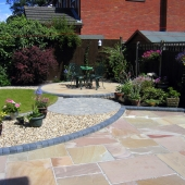 after-indian-stone-patio-with-curved-themed-garden